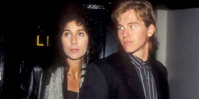 Cher and Val Kilmer attend Bette Midler's video party in 1984.