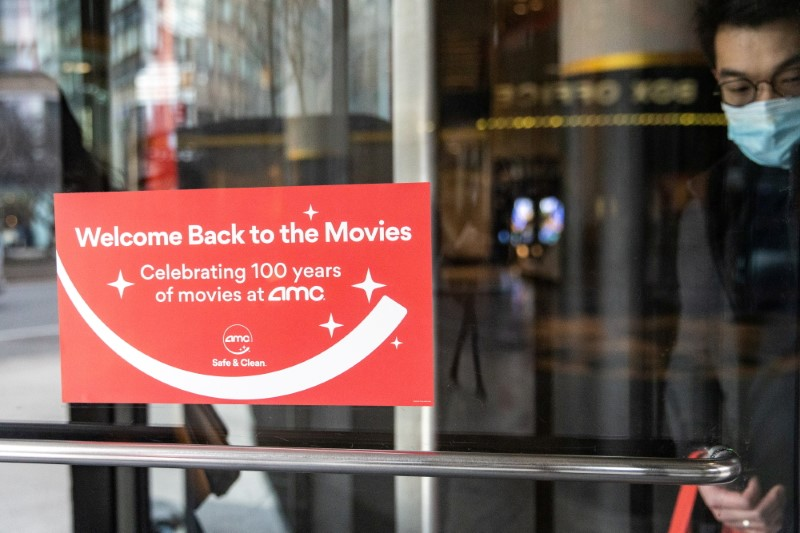 Welcome signage is seen outside the AMC movie theatre in Lincoln Square, amid the coronavirus disease (COVID-19) pandemic, in the Manhattan borough of New York City, New York, U.S., March 6, 2021. REUTERS/Jeenah Moon