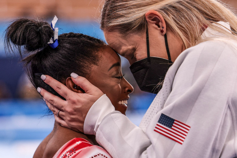 Tokyo, Japan, Tuesday, August 3, 2021 - USA gymnast Simone Biles is congratulated by her coach Cecile Landi as it becomes evident she will earn a medal in the Women's Balance Beam Final at Ariake Gymnastics Centre. (Robert Gauthier/Los Angeles Times)